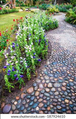 stone path walkway in garden - peaceful rock stone massage relaxing - stock photo
