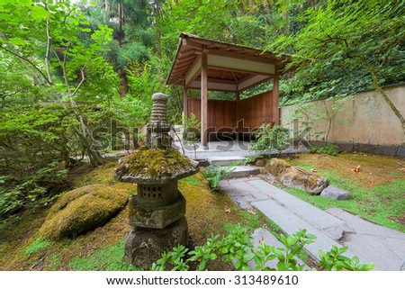 Stone Path with Wood Entry Structure and Landscaping Rocks at Japanese Garden in Portland Oregon - stock photo