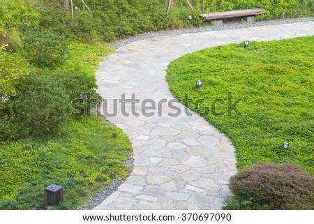 Stone pathway design in beautiful Japanese garden - stock photo