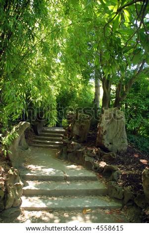 Stone pathway in asian garden - stock photo