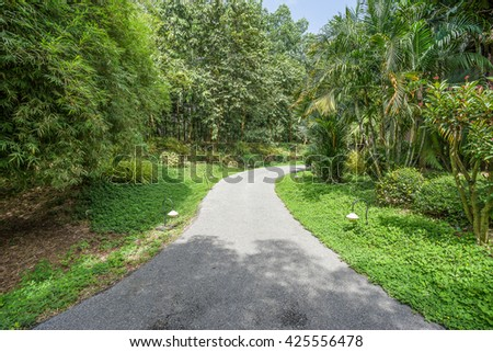 Stone Pathway in the Green Park - stock photo