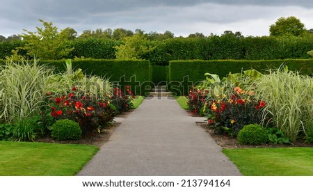 Stone Pathway through a Beautiful Green Park - stock photo