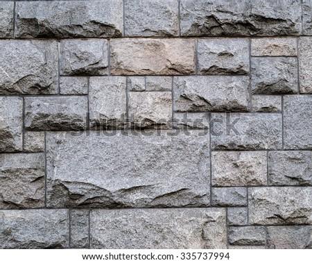 Stone pavement texture. Granite cobblestoned pavement background - stock photo