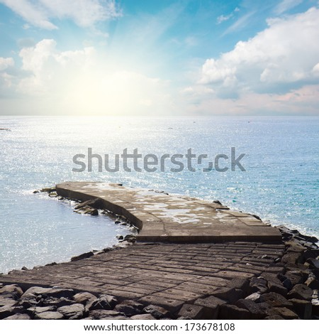 stone pier in the calm blue  see at sunny day - stock photo