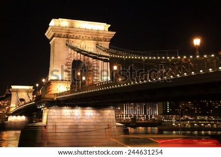 Stone pillar and decorative lights of the Chain bridge during night, Budapest, Hungary - stock photo