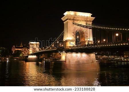 Stone pillars of the Chain bridge illuminated at night, Budapest, Hungary - stock photo