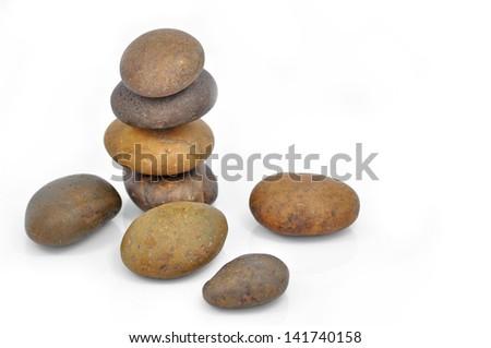 stone pyramid isolated on white background - stock photo