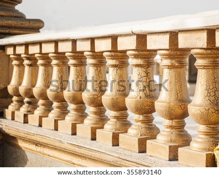 stone railing on the bridge in the park. - stock photo