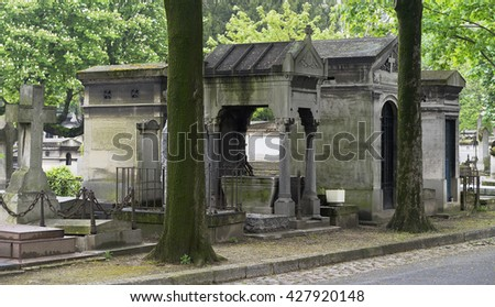 Stone religious crypt memorials and monuments in an european graveyard cemetery for remembrance and mourning - stock photo