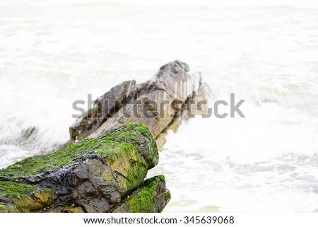 Stone sand and water in the morning at Songkhla Lake blurred background:select focus with shallow depth of field:ideal use for background.