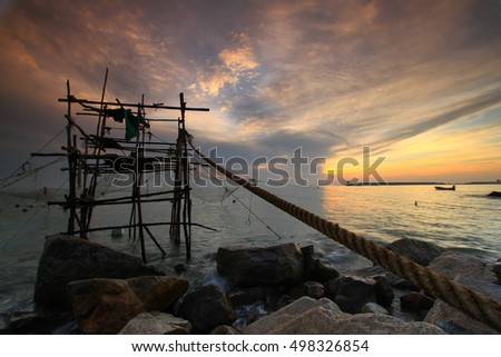 Stone,sand,sea water and beach with lighting in the morning:Close up,select focus with shallow depth of field:ideal use for background