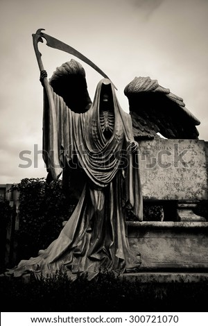 Stone Sculpture of Grim the Reaper [Death Taker or Angel of the Death], Processed in Dark Sepia with Grained and Vignette Effect - stock photo