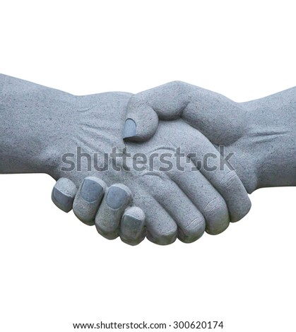 stone sculpture of shaking hands isolated on white background. - stock photo