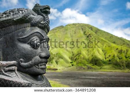 Stone sculpture on entrance of Bentar Candi and Batok volcano in Bromo Tengger Semeru National Park, East Java, Indonesia - stock photo