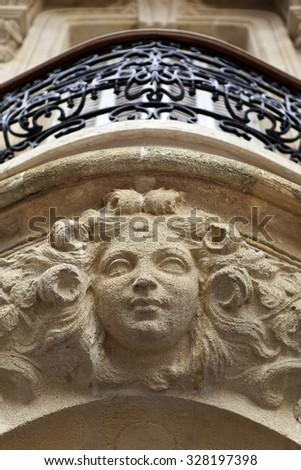 Stone sculpture on the facade of a French house in Bordeaux