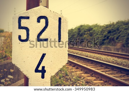 Stone signal in the railway line. Retro vintage style. Horizontal image.