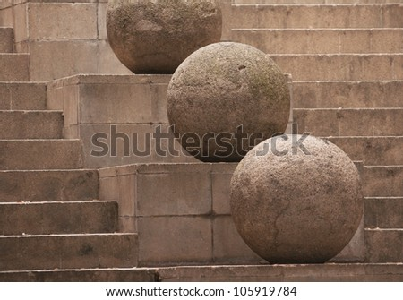 Stone sphere on the stairs background - stock photo