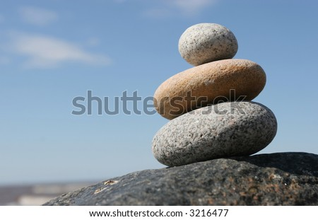 Stone stack against the blue sky