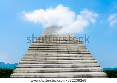 stone stair in the way up to blue sky - stock photo
