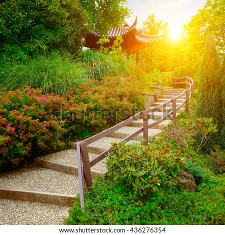 stone staircase in beautiful park at dawn - stock photo
