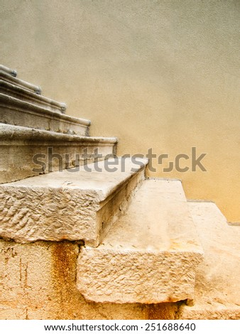 stone stairs on house wall - stock photo