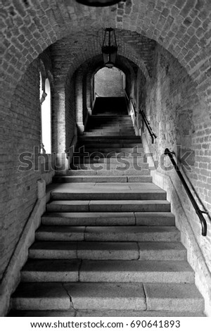 stone stairway in a medieval castle in black and white