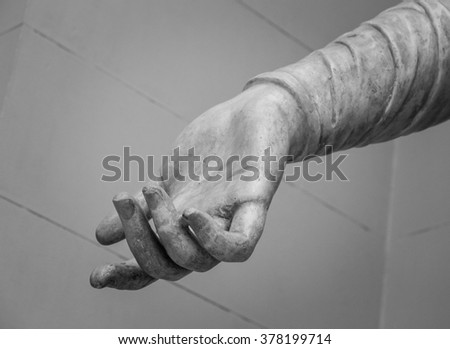 stone statue detail of human hand  - stock photo