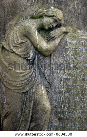 stone statue in a cemetery / graveyard in london england - stock photo