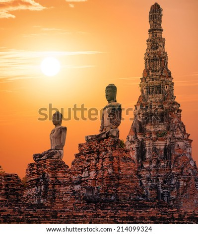 Stone statue of Buddha at sunset in Ayutthaya, Thailand - stock photo