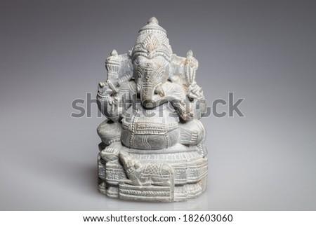 stone statue of the Hindu god Ganesha - stock photo