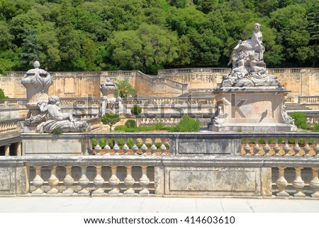 Stone statues decorates the Fountain Gardens, Nimes, Provence, France - stock photo