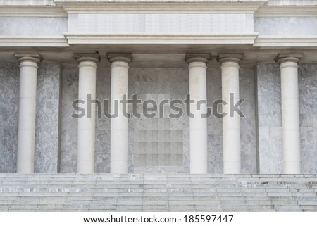 Stone steps and entry way with columns