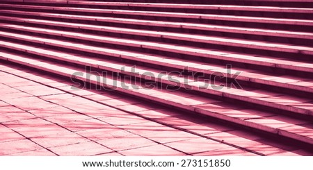 Stone steps in detail as an abstract pattern in red monochrome - stock photo