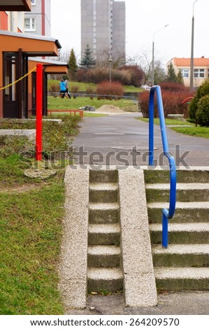 Stone steps leading to apartment buildings - stock photo