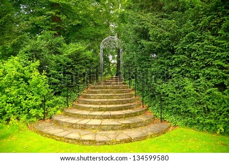 stone steps planted English style in garden - stock photo