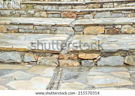 Stone steps with a gulley for rain water - stock photo