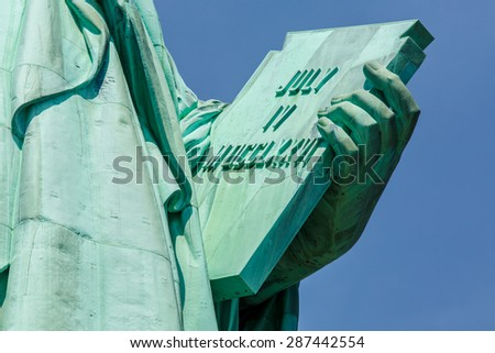 Stone tablet held by Statue of Liberty - stock photo