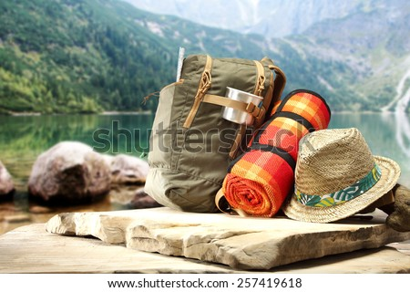stone top and backpack  - stock photo