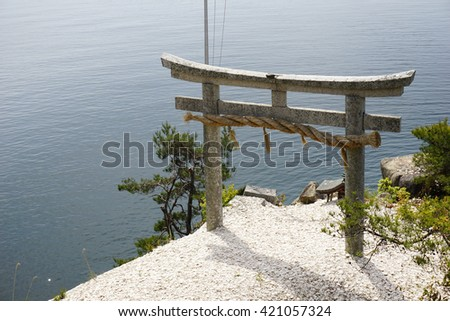 Stone torii and lake Biwa