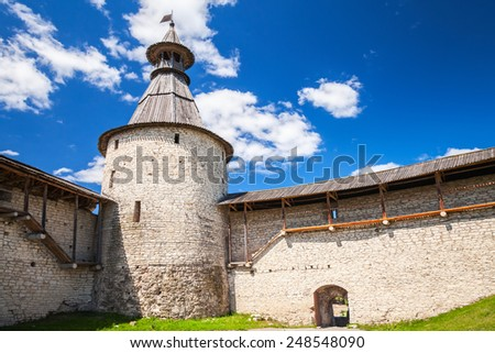 Stone tower and walls of old fortress. Kremlin of Pskov, Russia. Classical Russian ancient architecture