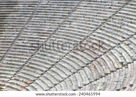Stone tribunes with diagonal stairs of an ancient amphitheater, Epidaurus, Greece - stock photo