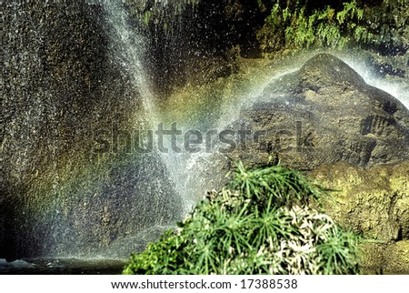 Stone under a jet of Waterfalls  in a province Trinidad, Cuba