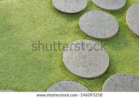 stone walk way on green grass  - stock photo