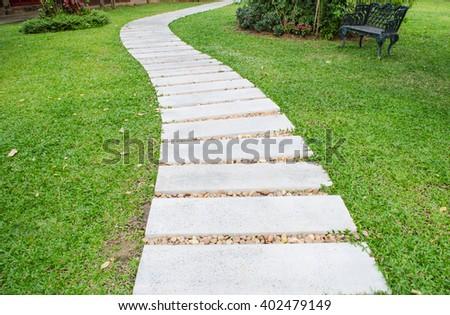 Stone Walking Path Squares On A Garden Lawn.