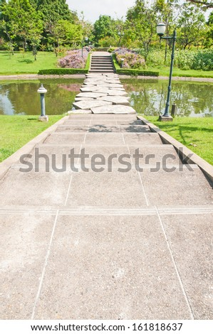 stone walkway across water in the park