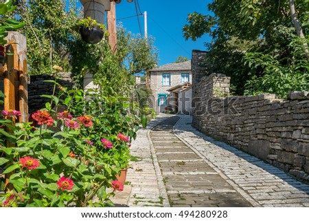 Stone walkway and house in Monodendri, one of the stone villages of Zagoria, Epirus, Greece
