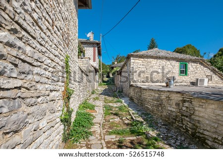 Stone walkway and houses in Monodendri, one of the stone villages of Zagoria. Epirus, Greece