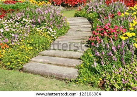 stone walkway in flower garden - stock photo