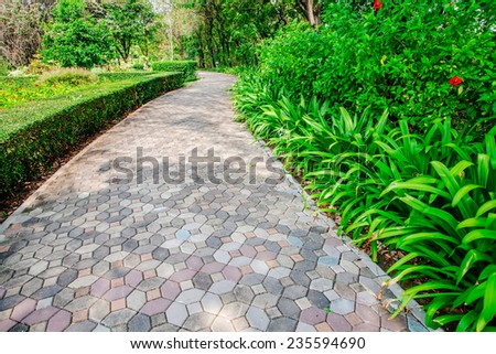 Stone walkway in the green park. - stock photo