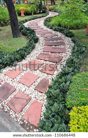 Stone walkway in the park . - stock photo